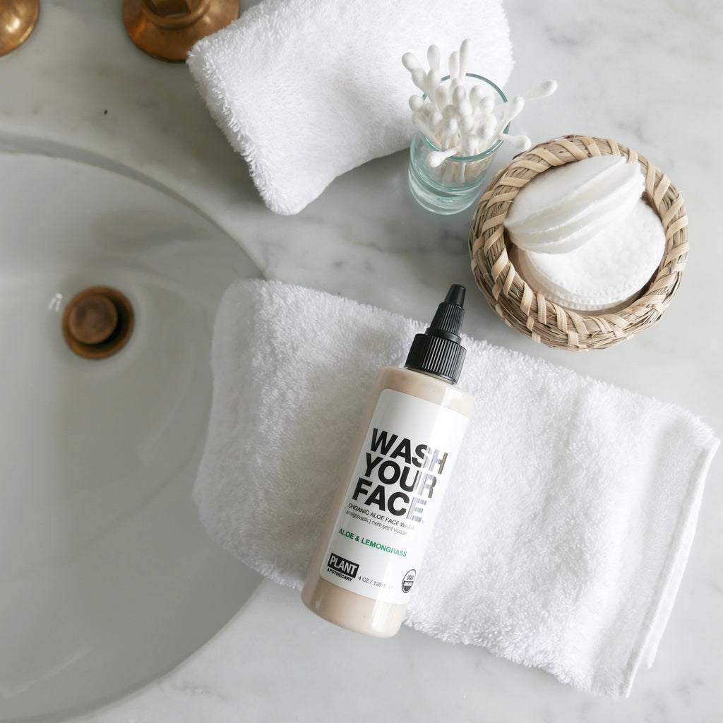 WASH YOUR FACE Organic Aloe Face Wash on top of white hand towel
