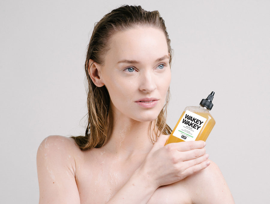 Woman holding WAKEY WAKEY Organic Body Wash in her hand