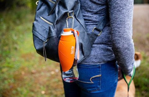 Easily clip the Mighty Paw Travel Dog Water Bottle to your backpack or to your dog's harness