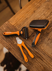 MightyPaw.com   Dog grooming brush, rake and nail clippers