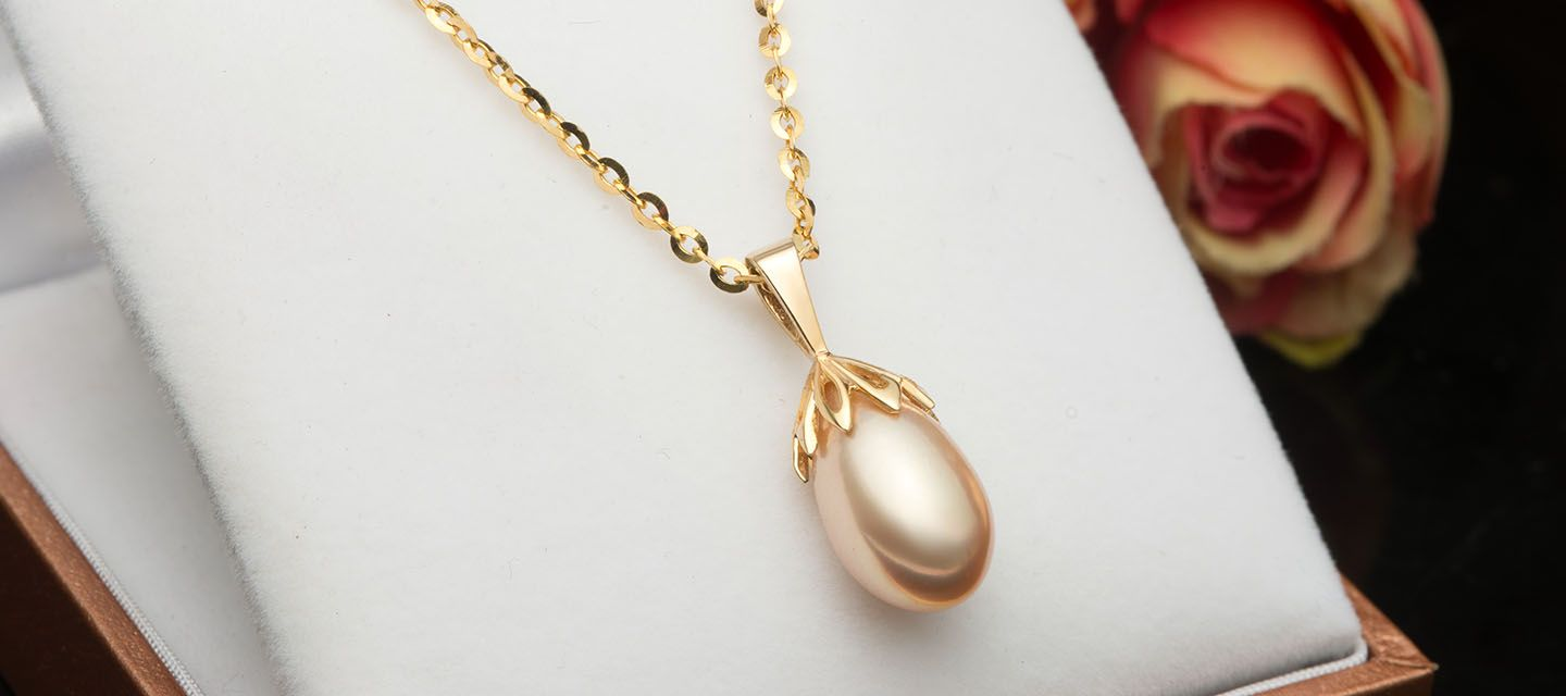 pearl pendant in gold ame jewellery