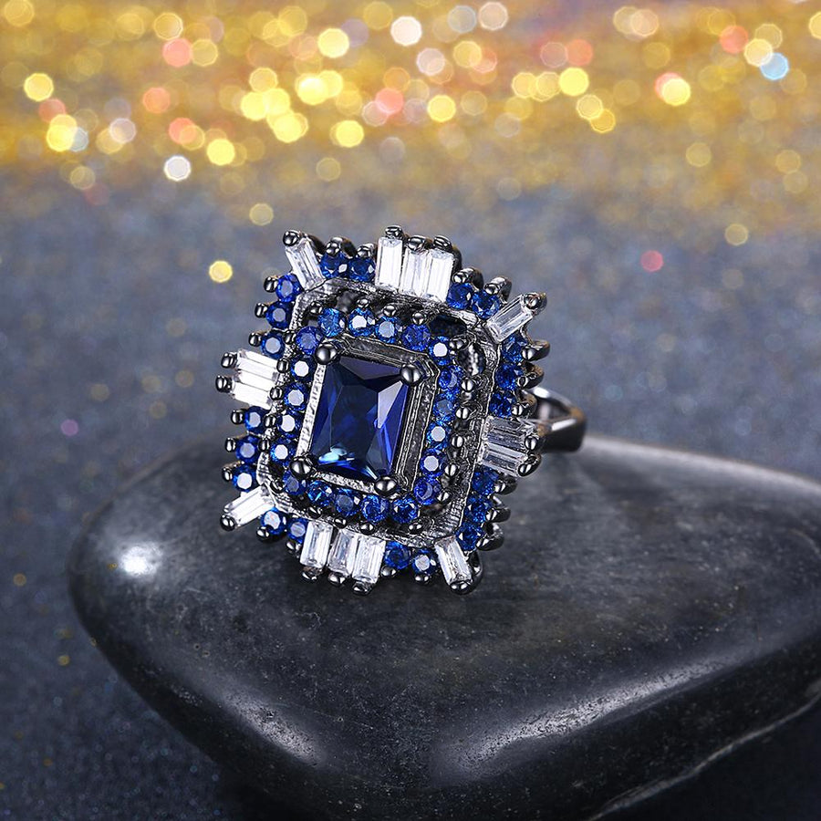 Blue & White Swarovski Halo Ring in Black Gun Plating - InspoArt