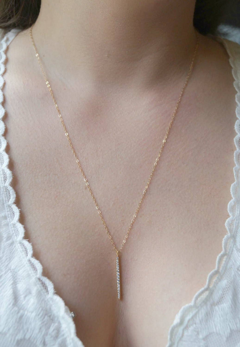 Wander + Lust Jewelry - Vertical Bar Necklace, , Wander + Lust Jewelry, Faire, Jewelry, Necklaces, The vertical bar necklace adds that touch of sparkle to every outfit! This delicate gold necklace is so simple and chic... Layer it with other necklaces to create a gorgeous layered look. It features cubic zirconia vertical bar pendant.