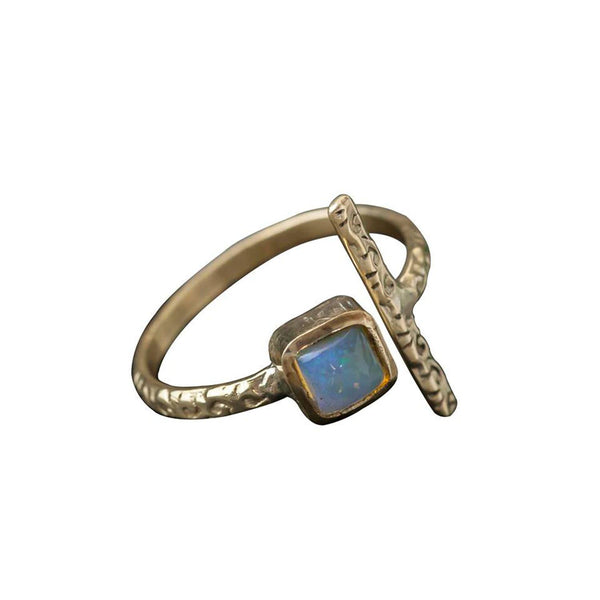 Brass Opal Bar Ring, Rings, Baizaar, Rings, Brass ring featuring opal stone by Baizaar. Baizaar's brass collection is a mix of entirely handmade pieces and cast designs, with all details being hand carved. Made by skilled metal smiths in the Rajasthan region of Northern India. The brass is a combination of zinc and copper and is nickel-free