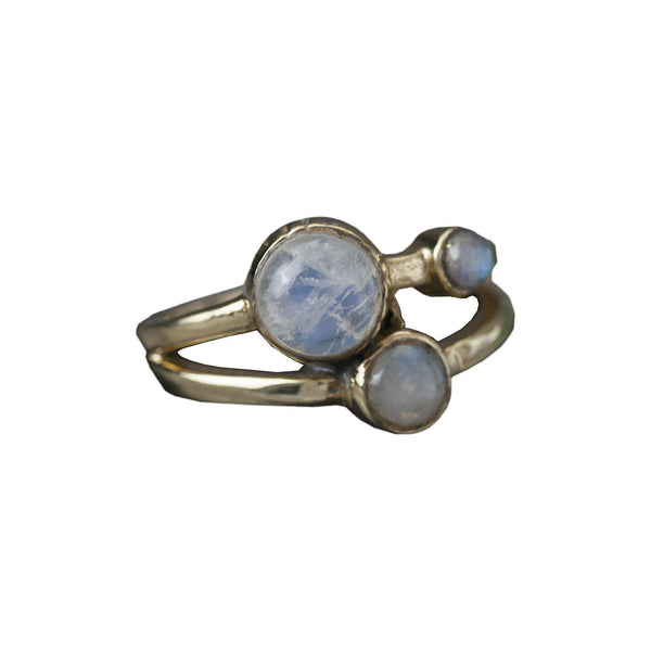Brass Triple Moonstone Ring, Rings, Baizaar, Rings, Brass ring featuring 3 moonstones by Baizaar Baizaar's brass collection is a mix of entirely handmade pieces and cast designs, with all details being hand carved. Made by skilled metal smiths in the Rajasthan region of Northern India. The brass is a combination of zinc and copper and is nickel-free.