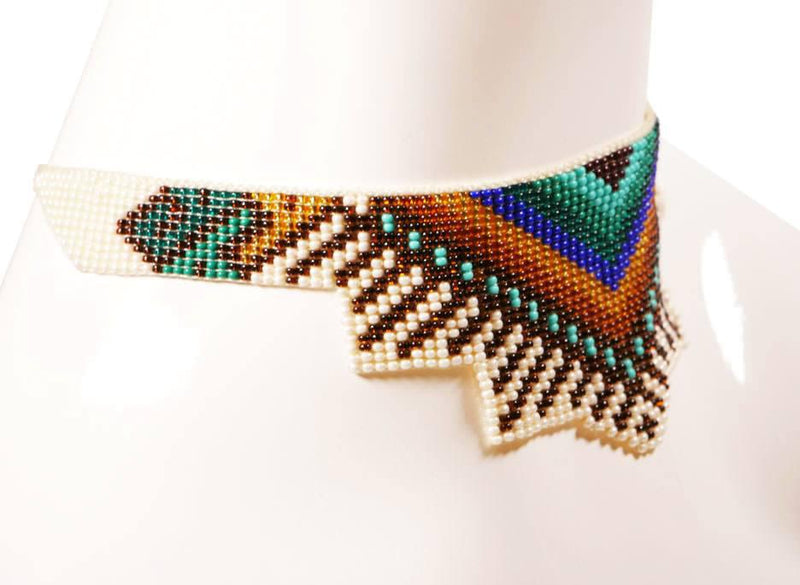 Taxco Beaded Choker, necklace, Wherevershegoes, Jewelry, Necklaces, Handmade in Taxco, Mexico, our beaded choker necklace is sure to jazz up any outfit. Adjustable cord ties in the back. Each piece is one of a kind so color and pattern may vary slightly. One size fits most. Available in: 1. blue, black and yellow pattern 2. white, red and green pattern By Quarzoma Jewelry