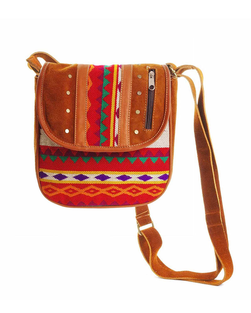 "Quito Saddlebag in Tan, handbag, Wherevershegoes, Crossbody, Quito, Make a statement with the perfect-sized ""daytripper""; the Quito Saddlebag. The beautiful woven wool design is adorned with leather and stud detailing. Long adjustable strap allows it to be worn as a shoulder bag or crossbody. Flap cover with snap closure and a zippered pocket inside. H 10 in W 9 in L 2 in"