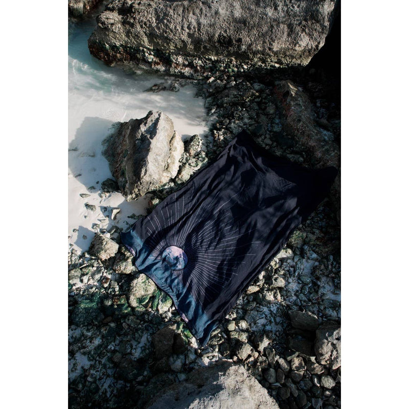 "Moonsky Blanket by Nightswim, blanket, Nightswim, blanket, Two-sided sand-resistant quick-dry multipurpose beach towel Navy blue plush fabric for drying made with 84% organic cotton and 16% polyester reprieve Printed woven fabric made of 100% rayon from regenerated cellulose natural fibers. Digitally printed to conserve water and reduce toxic dye runoff into the seas. machine wash cold on gentle cycle then hang dry. Dimensions 61"" l x 41.5"" w"