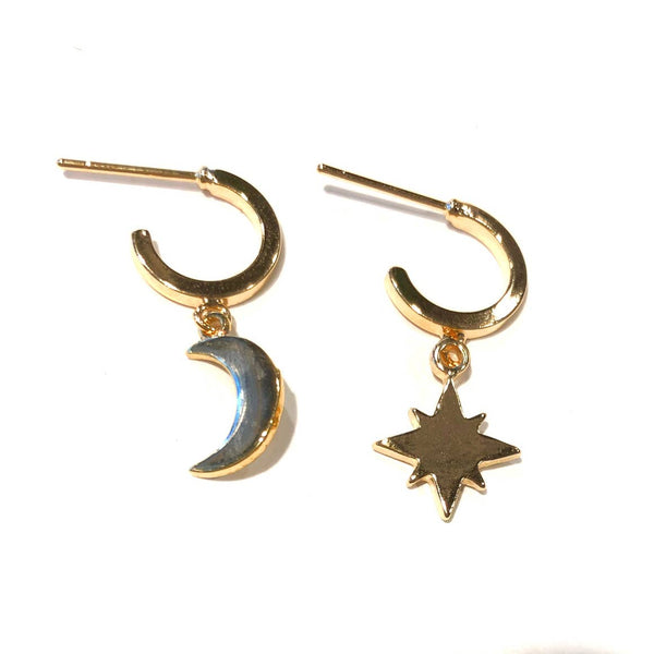 Star & Moon Golden Hoop Huggies, earrings, Nikki Smith Designs, Earrings, In case you haven't heard...2019 is the year of mismatched jewelry! We're so onboard with this trend. Tiny hoop huggies with a hanging moon and star charm. Nickel-free and hypoallergenic by Nikki Smith Designs