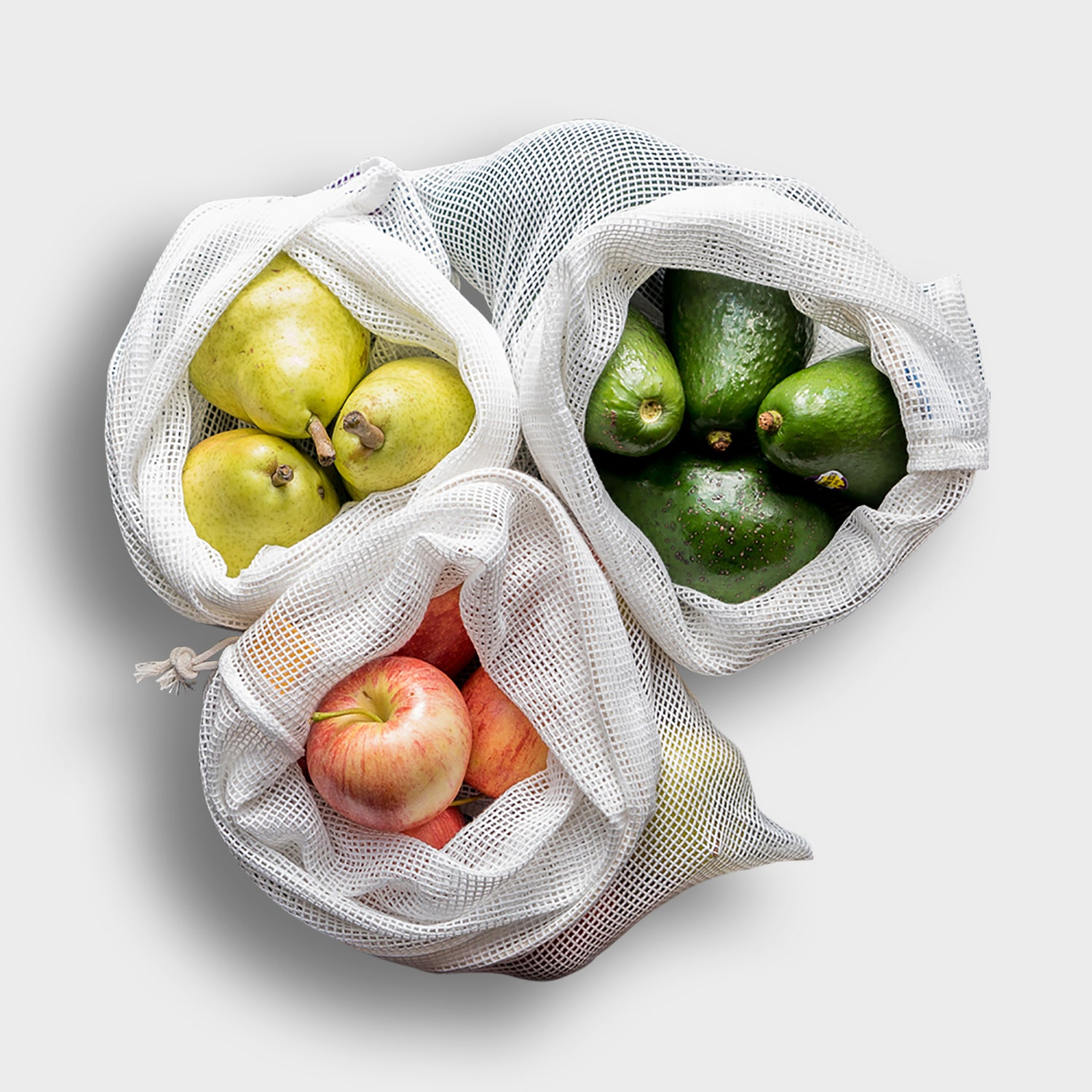 Bundle of three produce bags, containing pears, avocados and apples