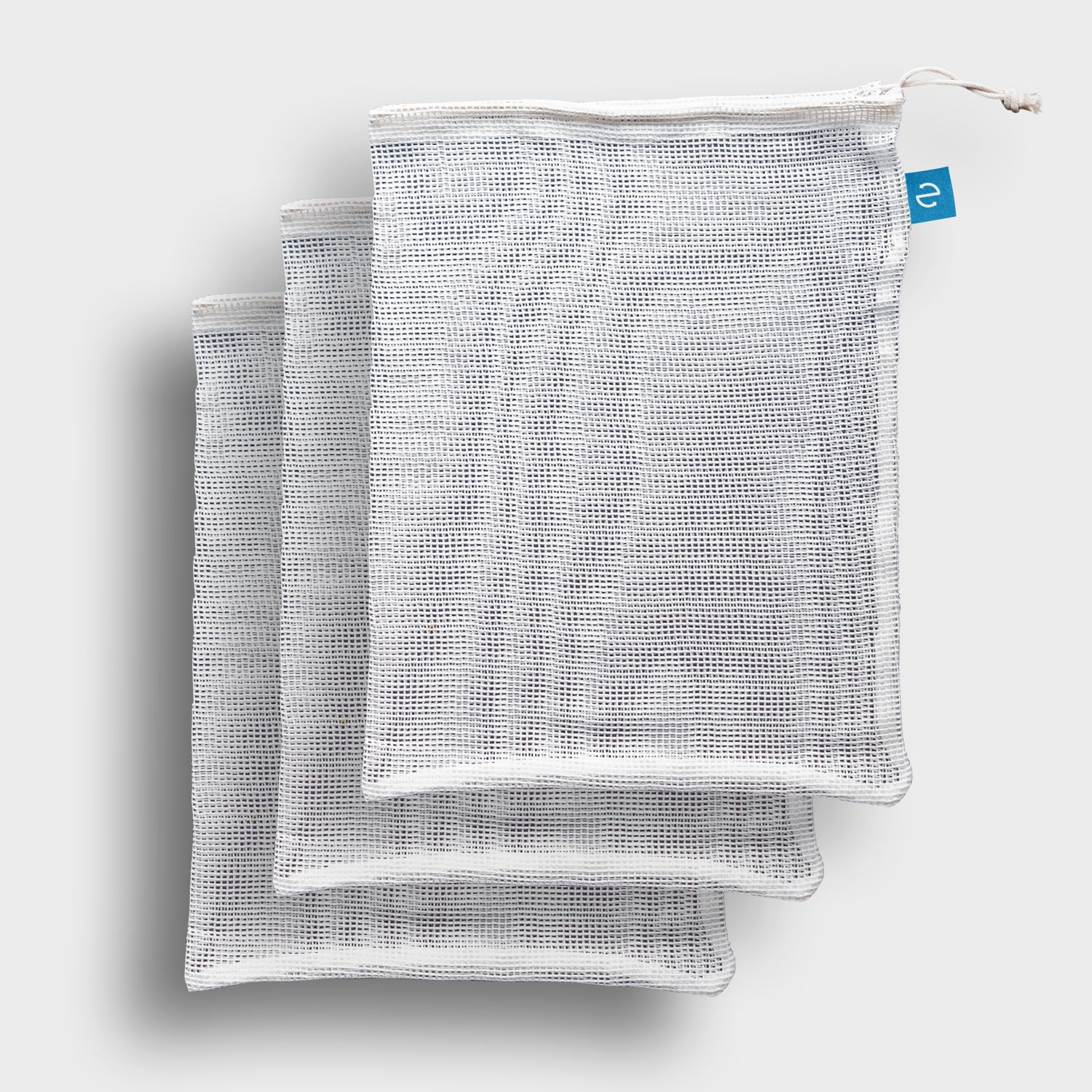 Stack of three cotton mesh produce bags with blue icon logo