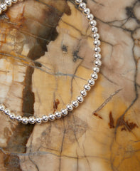 Small Silver-tone Ball Bead Stretchy Bracelet