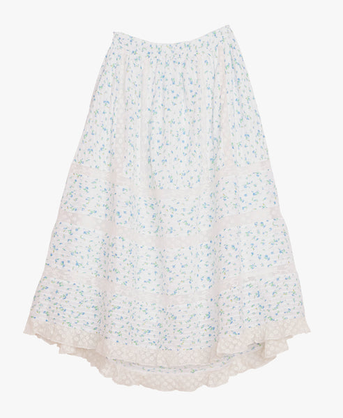 Cotton ditsy floral print,  pintucking and lace details come together in this piece to create the perfect Summer skirt. Elastic waist allows for an easy fit and the flirty hem takes this piece from day to night.