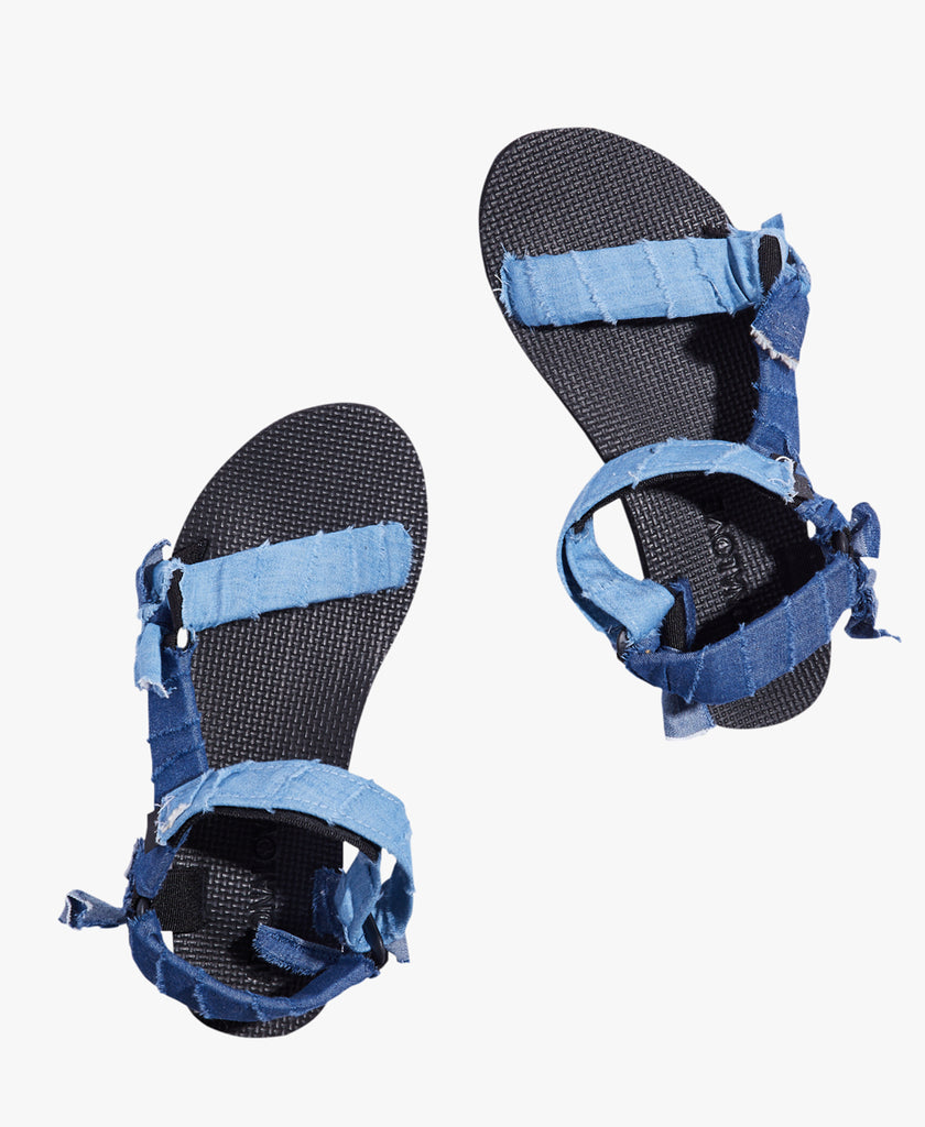 Made from recycled plastic bottles Material: outer: 100% polyester ; lining and sole -100% rubber Imported