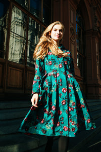 Waterproof design coat Rosalie by RainSisters: Red Rose pattern on emerald green background
