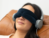 Woman wearing eye mask and listening to meditation