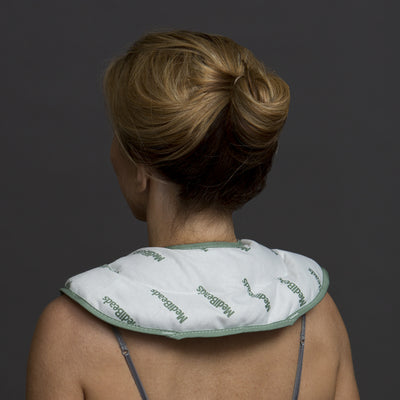 Women with MediBeads Moist Heat Pads around back of shoulders