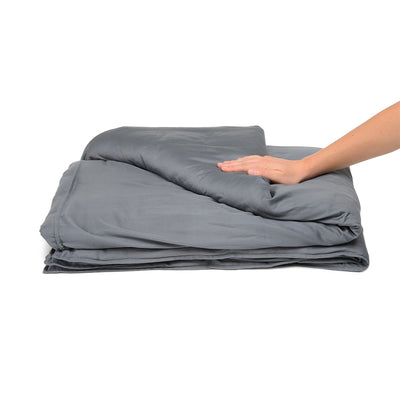 Delos weighted blanket folded with a hand