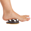 A foot on top of the Moji Pro Foot Massager