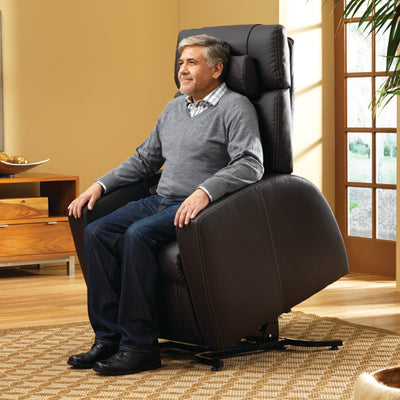 Man using the lift assist feature of the Luma chair half way to standing up