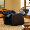 Man using the lift assist feature of the Luma chair to recline almost flat