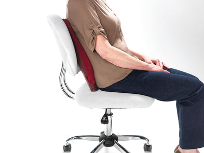 Women sitting on top of the Spina-Bac® Ergonomic Back Cushion