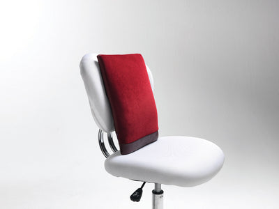 Spina-Bac® Ergonomic Back Cushion on top white chair