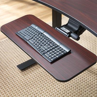 Keyboard Tray setup on a brown desk in office