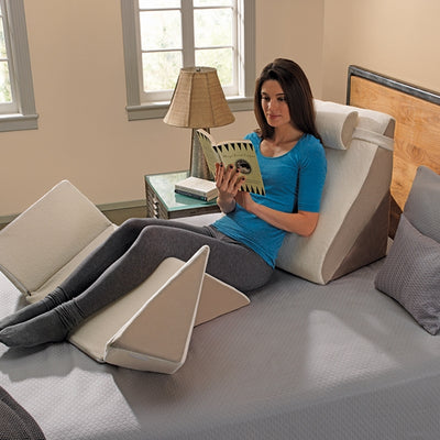 Women reading while supported by the ContourSleep Bed Wedge System