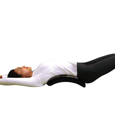 Women using the Lumbar Back Stretcher on her back