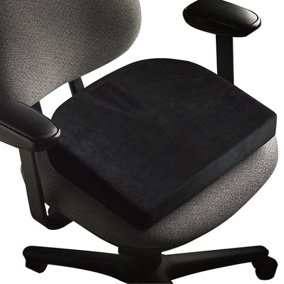 Side view product image of the ContourSit Wedge Cushion in a gray chair