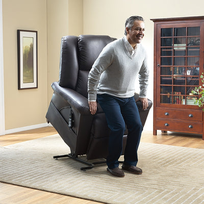 Man being assisted to stand up using the DreamMaker Lift Chair