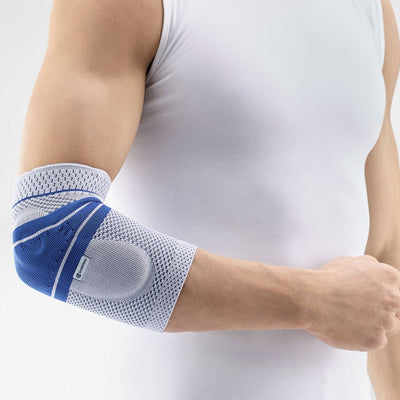 Man in tank top using the EpiTrain Arm Brace on Right Arm