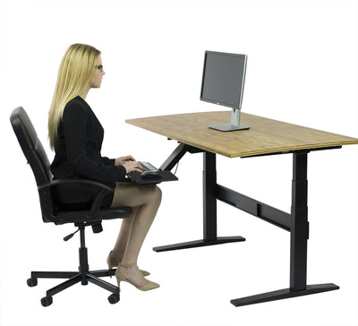 Women sitting at workstation using the Adjustable Keyboard Tray