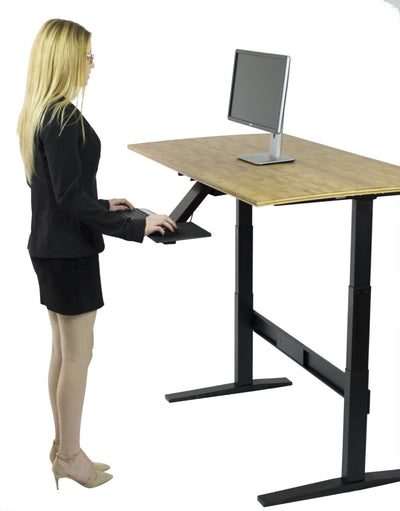 Women standing at workstation using the Adjustable Keyboard Tray