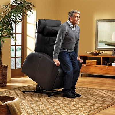 Man using the lift assist feature of the Luma chair