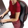 Women in red top using the contour lumbar cervical back cushion on a chair