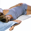 Young women in sleep pajamas lying on top of a contourSleep Lumbar Pillow