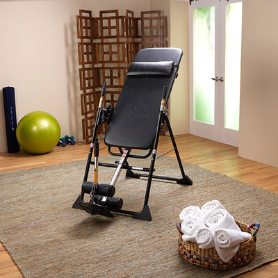 Women's entire body reclined back using the Mastercare Back-A-Traction Inversion Table
