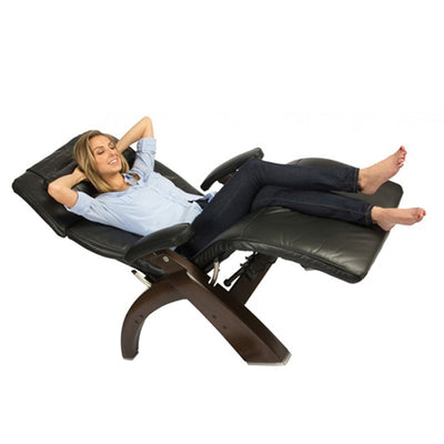 Women reclined back in the black Omni-Motion Silhouette Perfect Chair