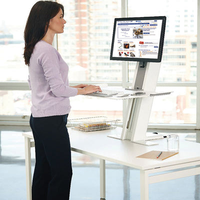 Women standing and using the QuickStand Workstation