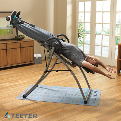 Man inclined back on the Teeter Contour L5 Inversion Table