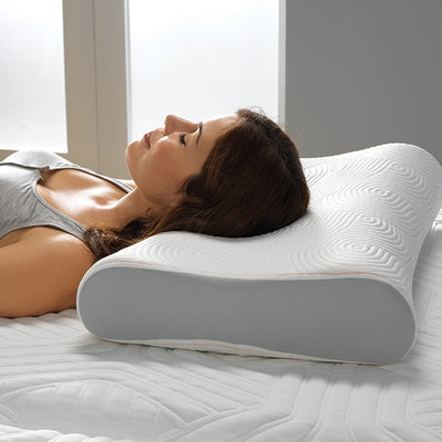 Women sleeping on the TEMPUR-Contour Side-To-Back Pillow in bedroom