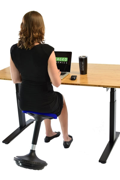 Women at desk with the wobble stool at a 45 degree angle