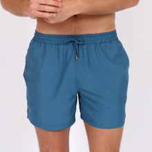 Load image into Gallery viewer, OWSS1801 Aegean Blue Solid Colour Original Weekend men's recycled polyester swim short with elastic waist on body front view