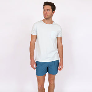 OWSS1801 Aegean Blue Solid Colour Original Weekend men's recycled polyester swim short with elastic waist styled with OWTS1804 Ice Blue Garment Dyed beach fit men's organic cotton t-shirt