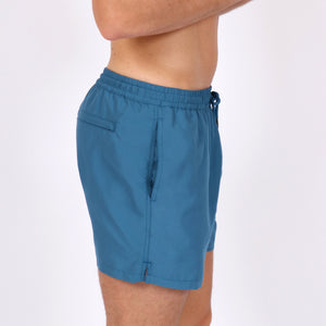 OWSS1801 Aegean Blue Solid Colour Original Weekend men's recycled polyester swim short with elastic waist on body side view