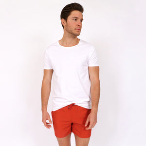 OWSS1801 Chili Red Solid Colour Original Weekend men's recycled polyester swim short with elastic waist styled with OWTS1801 White men's organic cotton t-shirt