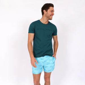 OWSS1803 Aqua Blue Holiday Van Print Original Weekend men's recycled polyester swim short with elastic waist styled with OWTS1802 Atlantic Green logo print organic cotton men's t-shirt