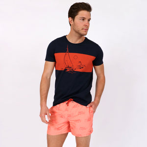 OWSS1803 Coral Pink Holiday Van Print Original Weekend men's recycled polyester swim short with elastic waist styled with OWTS1803 Somewhere Tropical Sail Boat Print men's organic cotton t-shirt